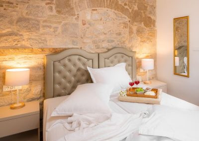 Hotel Agava in Babina - Deluxe Double Rooms bed and fruits